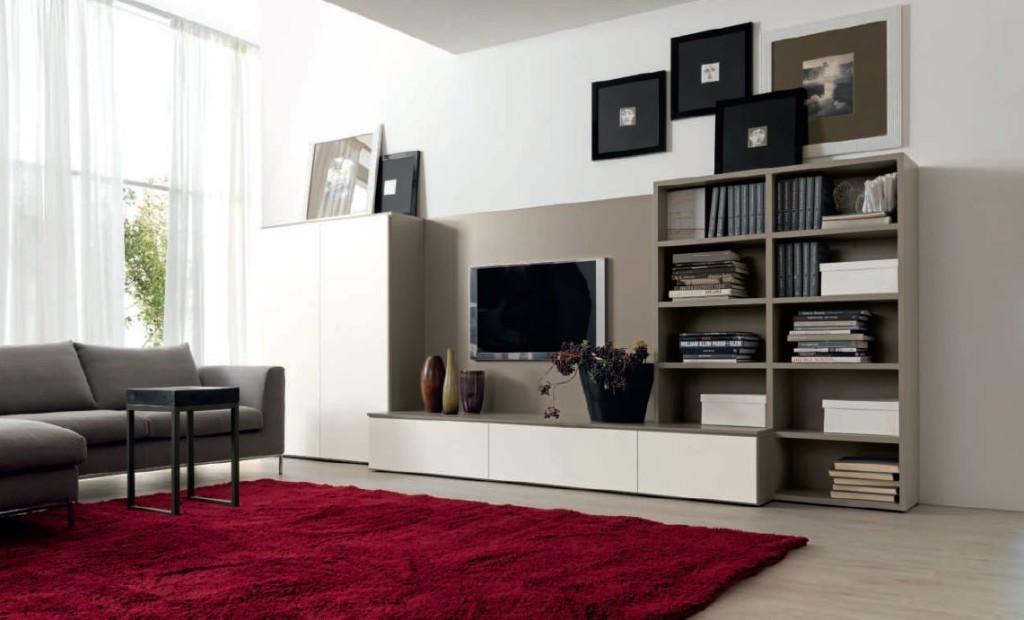 La demande du client: Aménagement d'un espace Tv, avec un poste télévision, des rangements et une bibliothèque. L'idée de l'architecte interieur levallois: Un fond central et fixe pour un écran suspendu. Les rangements coulissantes au sol comme «un plan déco». Les colonnes et les bibliothèques aux extrémités à architecture modulable et variable.Le résultat: Schéma libre, rythme géométrique pour un espace composable selon ses envies. La touche déco: un tapis rouge carmin qui introduit l'espace salon.